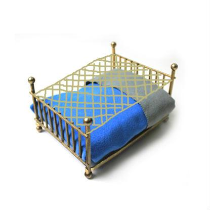 This is thin piece of netting that lays just about 4 inches above your bed.  This netting will support the weight of the cat so that it can still sleep right above its person but allow the person to move and not disturb the cat.